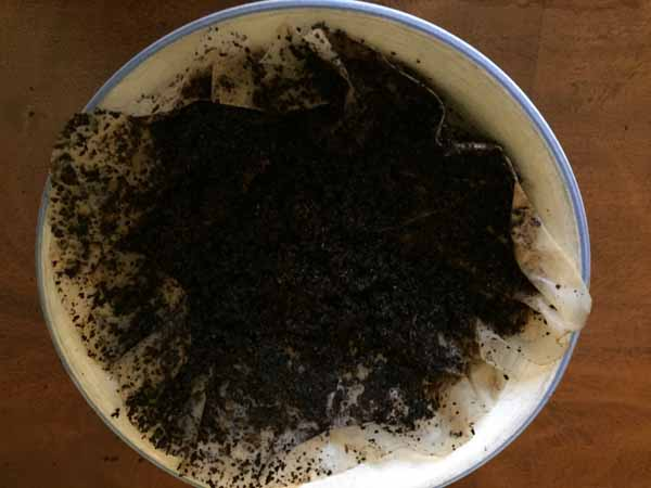 Conceal Furniture Scratches with Coffee Grounds - Wet Grounds