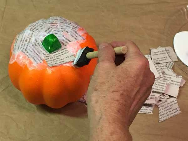 Decoupage Book Pumpkin - Apply Mod Podge and Paper